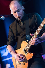 Stu Eccles-Skinner playing Guitar