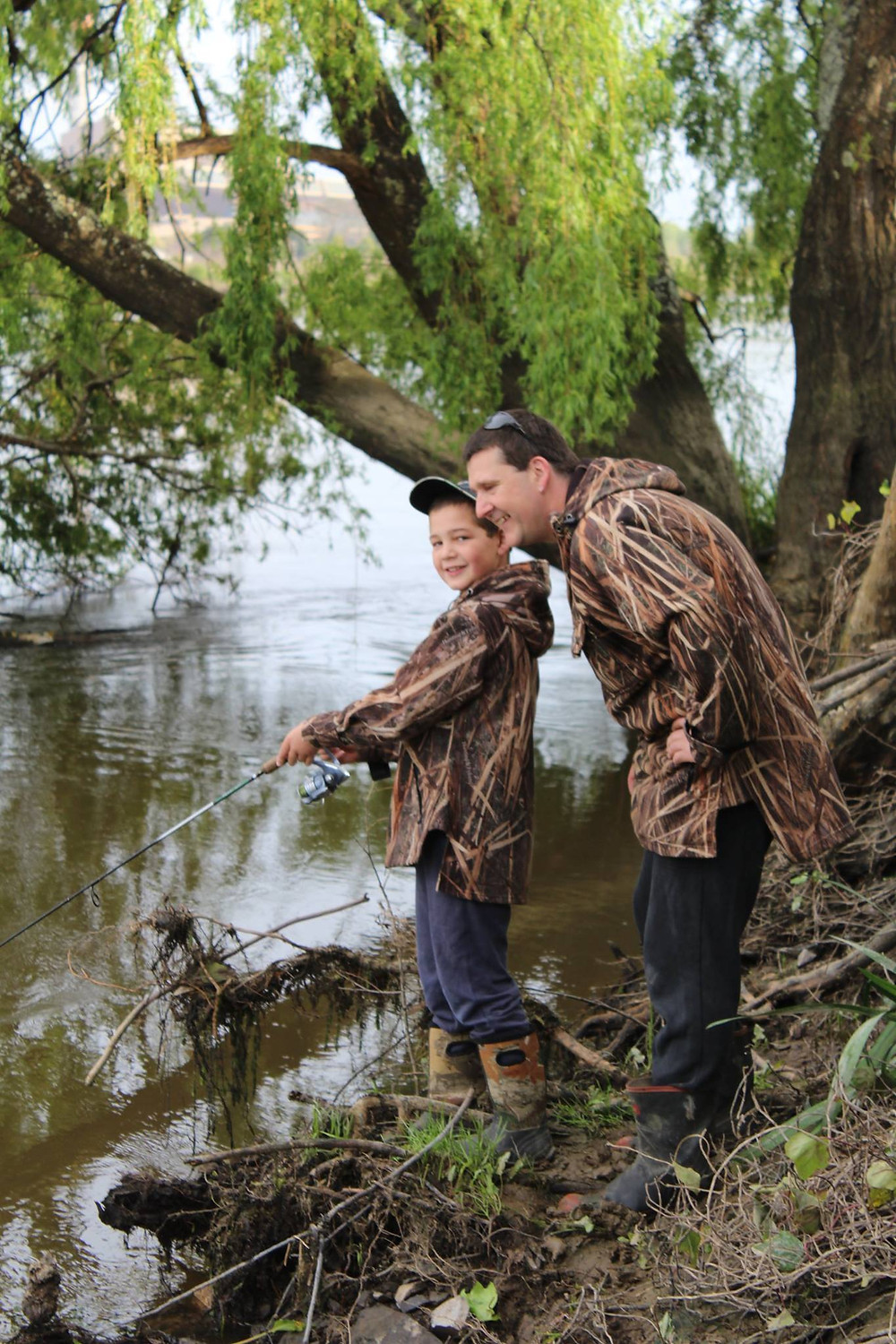 Dylan Farrar fishing with Dad Steven. Image supplied by Michael Lynch
