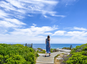 Woman walking on wooden walk way.jpg