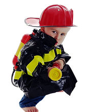 Crouching toddler fire fighter points wa