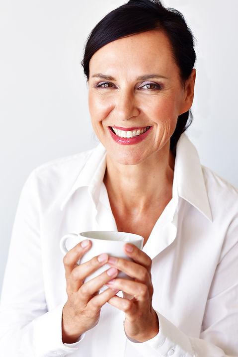 Iris Schaden having a cup of coffee