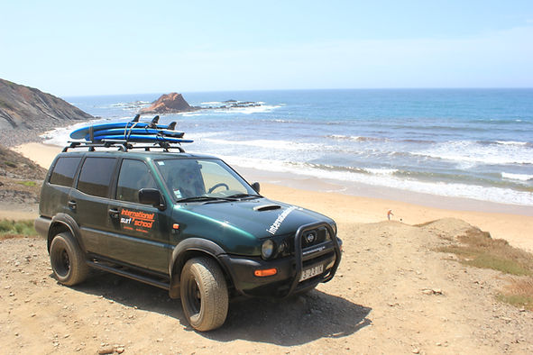 Jeep with boards used in the surf courses in a wild beach in Sagres Portugal