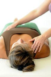 Woman receiving energy healing