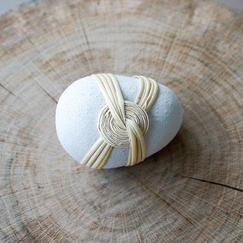 Ceramic stone with rattan wrapping