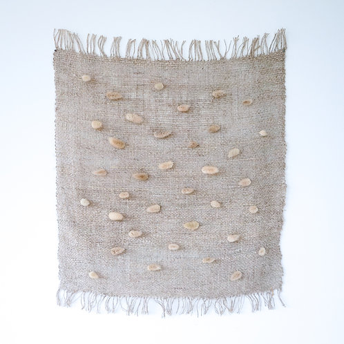 Handwoven linen wall hanging with hare's tail flowers