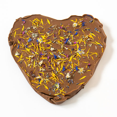 Chocolate heart with edible flowers