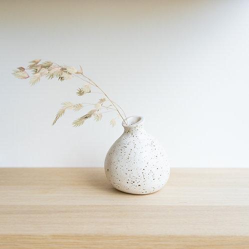 Small ceramic vase with white speckled glaze