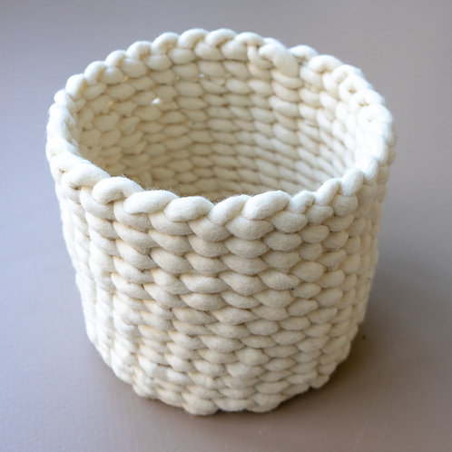 Handwoven basket from natural wool
