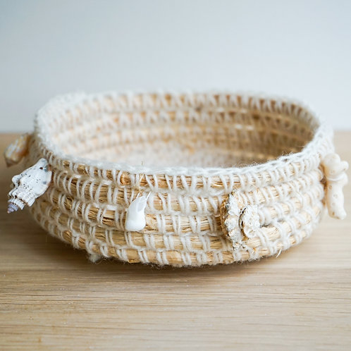Coiled basket with foraged stones and shells