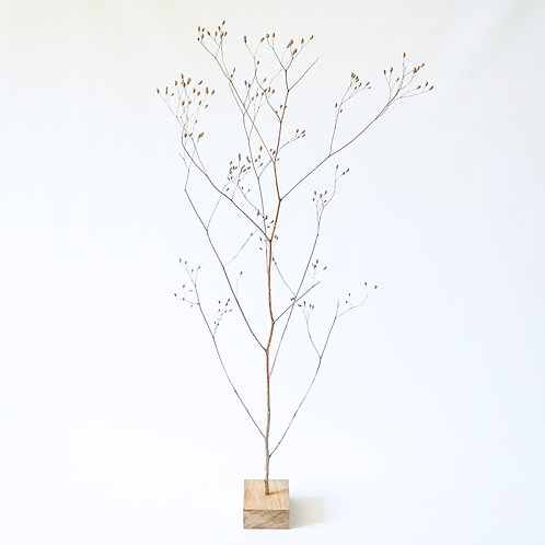 Dried flower with wooden block
