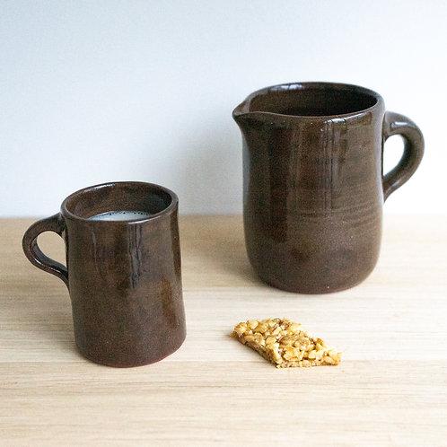 Set of brown ceramic milk jug and mug