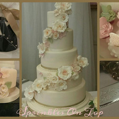 5 tiers with co-ordinating cupcakes, favour cookies and individual fruit cakes