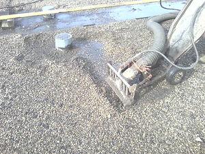 Wet roof vacuum
