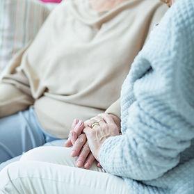 Leamington carer holding hand of elderly lady