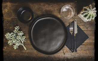 old-wooden-table-with-dishes-decorations-it-lights.jpg