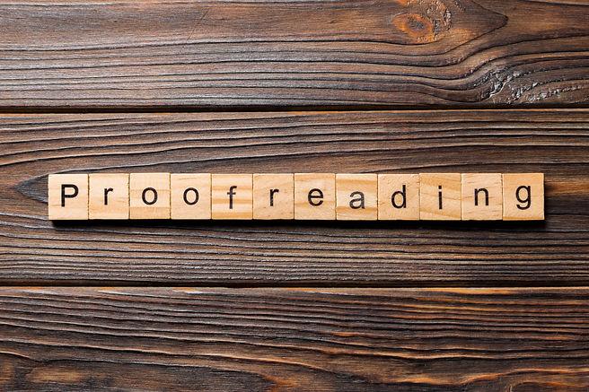 proofreading word written on wood block.