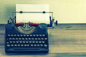 retro typewriter with white paper page o