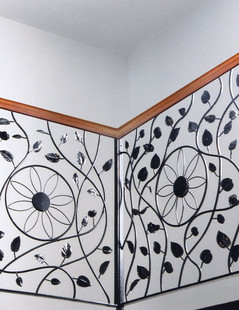 Medium: Steel Dimensions: 36 H (inches) Notes: This indoor ornamental iron railing was commissioned by Peter & Helen Dyck of Plum Coulee, Manitoba for their new home. It features a cherrywood hand rail for added beauty. (2003)