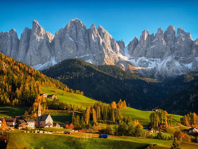 Funes valley with Dolomites mountains in autumn