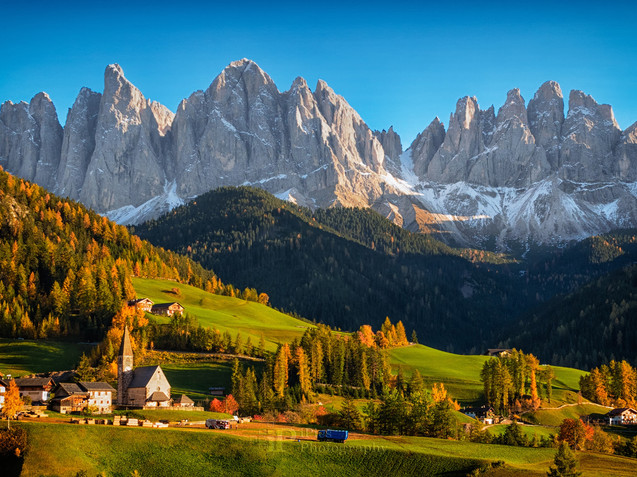 Village in Funes Valley with Dolomites mountains