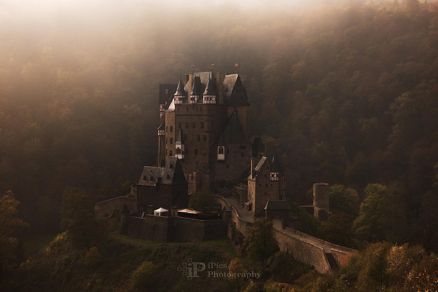 Burg Eltz Castle in the morning fog.jpg