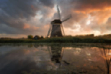 Explosive sunset over a windmill