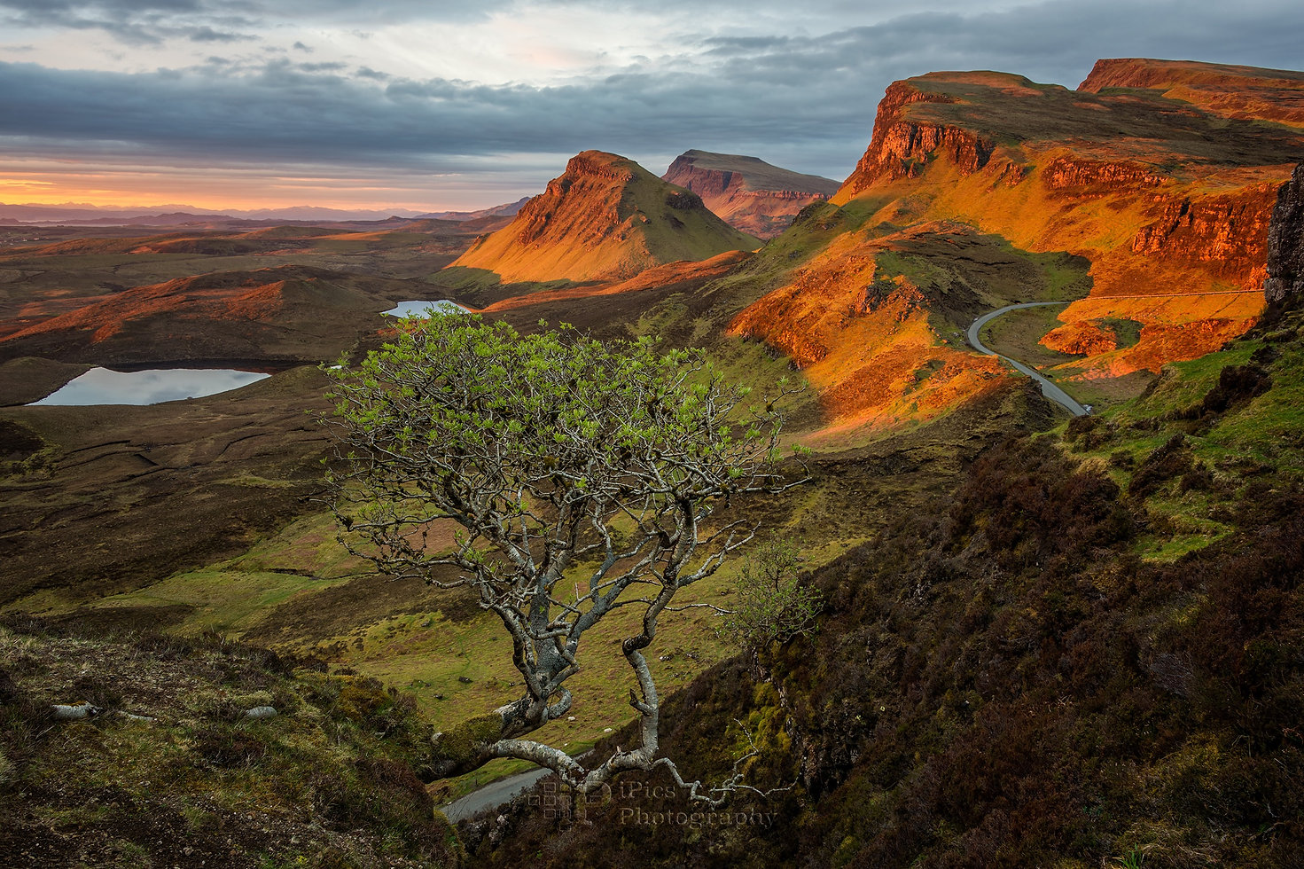 Sunrise on Isle of Skye with sun shining on the Quiraing mountains in Scotland.