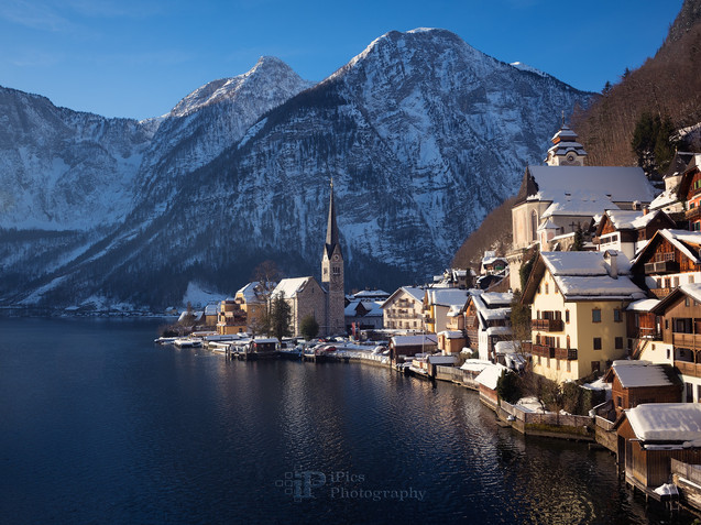 Hallstatt town with church in the snow