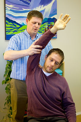 Stretching arm using assisted isolated stretching