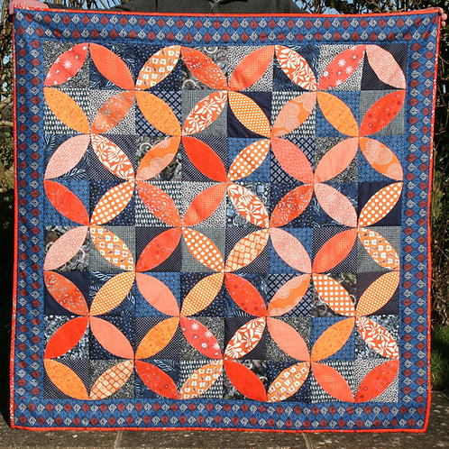 Navy and Orange Peel Patchwork Quilt