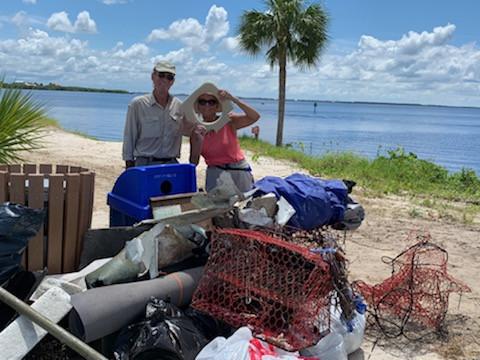 CHNEP volunteers standing behind collected trash
