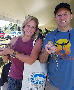 Participants holding reptiles