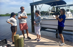 News crew at a dock