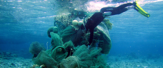 Diver next to debris underwater