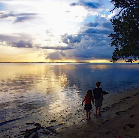 Image of sunset on the beach taken by Cara Czecholinski.