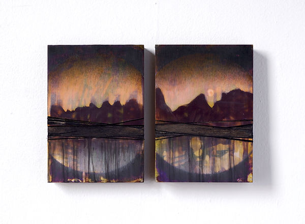 a painting diptych with carved panels comprised of black, purple, yellow pink and brown colors