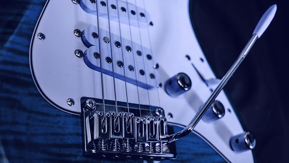 Close-up of blue & white electric guitar