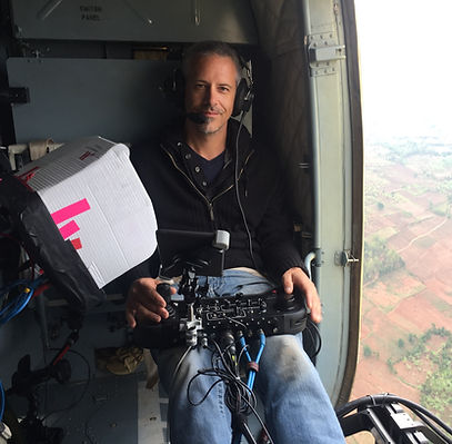 Mike Boidy Operating a GSS aerial camera for the President of Rwanda and Peter Greenberg