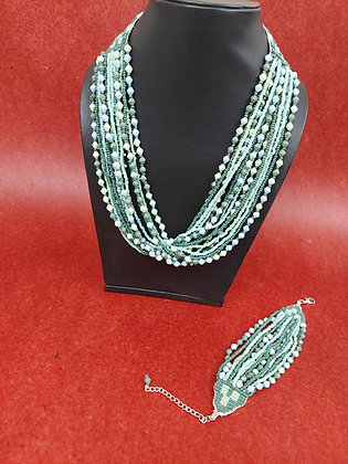 Green and white multi strand glass bead necklace and bracelet set. The bracelet closes with a white metal chain and lobster c