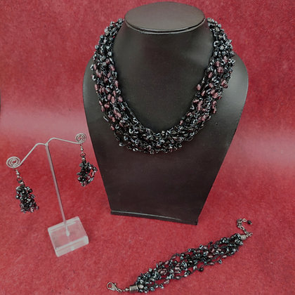 Multi-strand necklace and bracelet with matching cluster earrings in black and plum glass beads