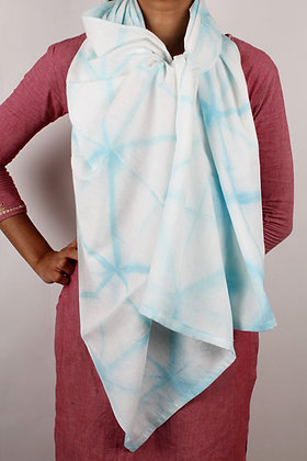 White hand woven cotton scarf with a delicate light turquoise resist dyed pattern of lines