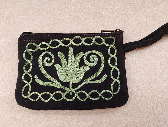 Black suede leather money purse with green flower crewel embroidery pattern.