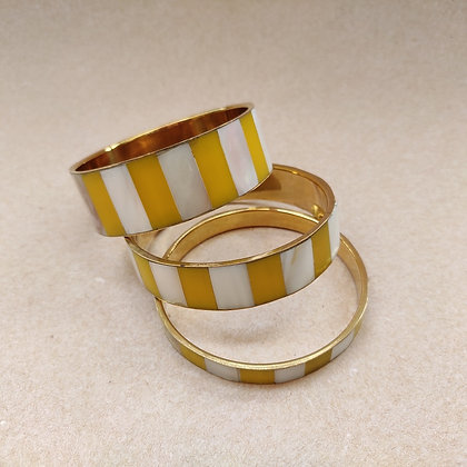 Set of three brass bangles with mother-of-pearl  and yellow resin inlay from MESH's jewellery collection
