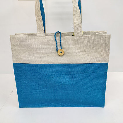 Two-tone jute bag with a coconut button closure.  The bag is blue and natural