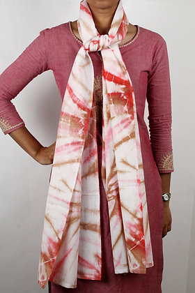 White handwoven cotton scarf with a rose and caramel resist dyed pattern
