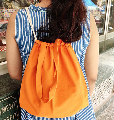 Orange organic cotton sling back-pack