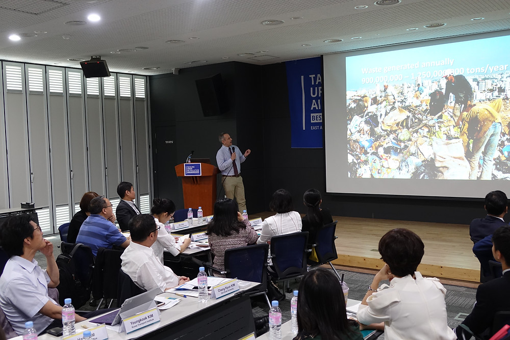 Participants listening carefully to the waste management presentation by Eric ZUSMAN from IGES.