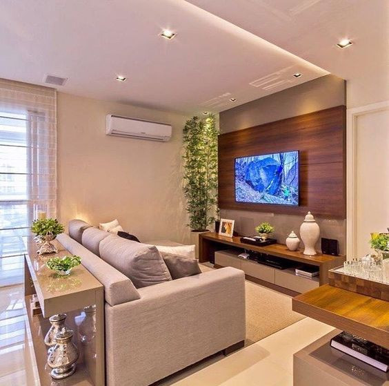 Sala de estar com tv. Projeto Mariane e Marilda Baptista.