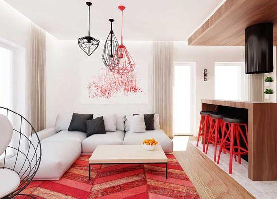 Sala com tapete e banquetas vermelhas.