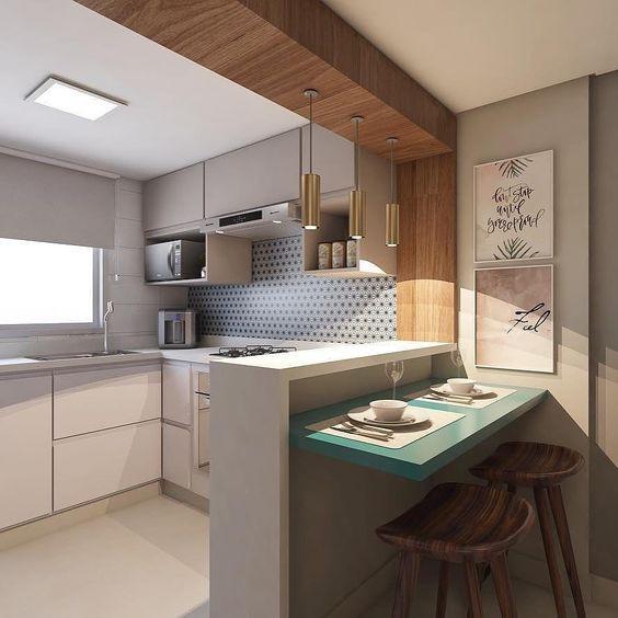 Cozinha com bancada para refeição. Projeto: Arq Design Analu.